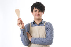 The youth who cooks. With an apron figure Stock Photography