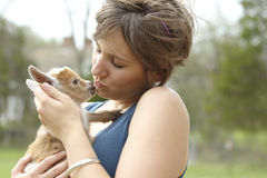 Youth Woman and Baby Goat Royalty Free Stock Photo