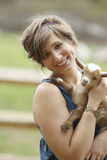 Youth Woman and Baby Goat Royalty Free Stock Image