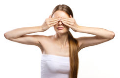 Youth woman clossing eyes with her hands Royalty Free Stock Photos