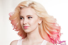 Youth women with colored curly hair on the white background. Beauty. Isolated. Studio. Gradient. Flying hairs royalty free stock photo