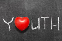 Youth. Word handwritten on blackboard with heart symbol instead of O Stock Photo