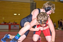 Youth Wrestlers in Tournament. Two young boys taking part in a wrestling tournament.  Gwinette county, Suwanee, GA Stock Photo