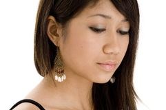 Youthful 8. A pretty teenage woman looks down and away Stock Photography
