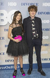 Youthful Actors at TV Premiere. Young actors Sterling Jerins and Charlie Kilgore arrive for the New York premiere of HBO's new family drama series, Divorce.  The Royalty Free Stock Photo