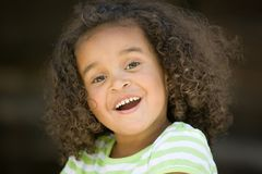 Youthful Confidence. Beautiful young girl child big brown eyes confident smile royalty free stock photo