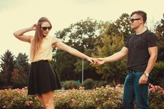 Youthful couple spending time together. Love romance relationship dating leisure.Youthful couple spending time together. Young girl and boy olding hands in park Stock Image