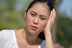Youthful Female Memory Problems. An attractive and asian person royalty free stock images