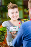 Youthful Flower Shop  Customer using Electronic Coupon. Young female customer in a busy flower shop using electronic coupon Stock Photo