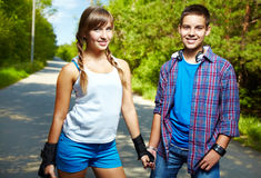 Youthful friends. Couple of happy teens looking at camera outside Royalty Free Stock Image