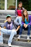Youthful friends. Portrait of happy teens on stairs looking at camera Stock Image
