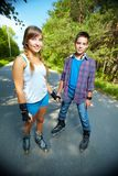 Youthful friends. Couple of happy teens looking at camera outside Stock Images