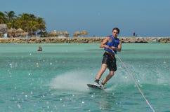 Youthful Guy Wakeboarding Off the Coast of Aruba Royalty Free Stock Images