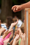 Youthful Hands Reach For A Butterfly Being Released At Festival Royalty Free Stock Image