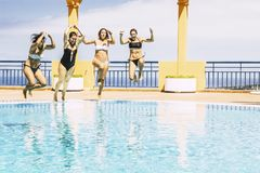 Free Youthful Happy Young People Jumping Together In The Swimming Pool Enjoying The Summer Holiday Vaction Season - Friends Hace Fun Stock Photos - 153557113