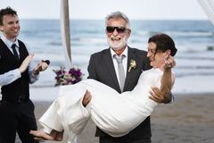 Youthful mature couple getting married at the beach Stock Photos