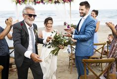 Youthful mature couple getting married at the beach stock photo