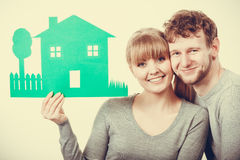 Youthful pair showing model. Love relationship ownership property concept. Youthful pair showing model. Adult married men women presenting home cutout planning Royalty Free Stock Photography