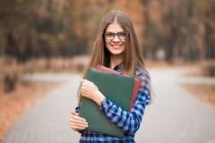 Youthful positive cheerful confident energetic female college student on way to class royalty free stock images