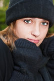 Youthful teen wearing winter mittens, scarf and hat Royalty Free Stock Photography