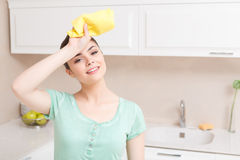 Youthful woman tired in kitchen Stock Photography