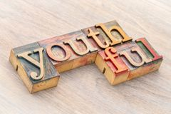Youthful word abstract in wood type. Youthful word abstract in letterpress wood type printing blocks Royalty Free Stock Images