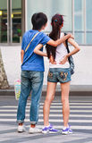 Youthfull lovers on the street, Shanghai, China Stock Photography