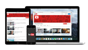 YouTube app logo on the iPhone iPad and Macbook Pro screen. YouTube multi devices set comprising Apple iPhone app logo, iPad Air2 application and desktop version Royalty Free Stock Photo
