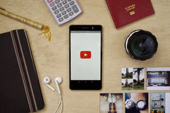 Youtube Application. KUALA LUMPUR, MALAYSIA - MAY 5TH, 2016: modern lifestyle with smartphone to stay connected and browsing favourite Apps. Watch favourite Stock Photography