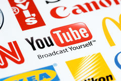 Youtube logo. Close up photo of the Youtube logo on the printed paper together with a collection of well-known brands of the world Royalty Free Stock Photography