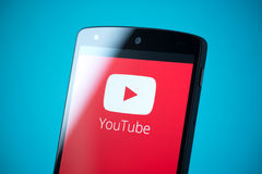 YouTube logo on Google Nexus 5. Kiev, Ukraine - September 24, 2014: Close-up shot of brand new Google Nexus 5, powered by Android 4.4 version, with YouTube Royalty Free Stock Photography