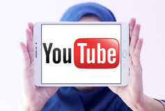 Youtube logo. Logo of youtube on samsung tablet holded by arab muslim woman Royalty Free Stock Photo