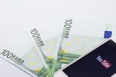 Youtube monetization. Smartphone youtube, banknote euro monetization Stock Image