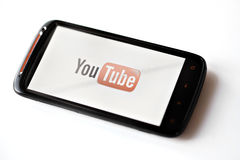 Youtube phone. Bucharest, Romania - March 28, 2012: Youtube logo is displayed on a mobile phone screen. YouTube is a video-sharing website, on which users can Stock Images