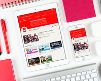 YouTube Red web page on display of iPad and iPhone Royalty Free Stock Photos