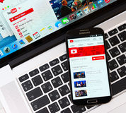 Youtube on Samsung Galaxy S4 device display. SIMFEROPOL, RUSSIA - NOVEMBER 01, 2014:  Youtube application on Samsung Galaxy S4 over Apple Macbook Pro keyboard Royalty Free Stock Photography