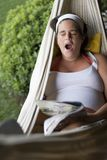 Yowning on a hammock Royalty Free Stock Photo