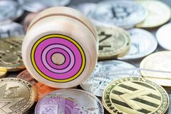 Yoyo effect of crypto currency price up so high and down, wooden. Yo-yo toy on various of physical cryptocurrencies coins, Bitcoin, Litecoin, zcash, ripple stock image