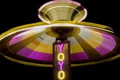 YoYo Swing Ride Spinning at Night Stock Photos