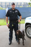 YPD transit bureau K-9 police officer and Labrador K-9 Ellis providing security at National Tennis Center during US Open 2014. NEW YORK - SEPTEMBER 8: NYPD Royalty Free Stock Image