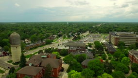 Ypsilanti Aerial. V1 Flying low over University campus panning left stock video footage