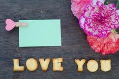 Ypu αγάπης αλφάβητου και λουλούδι γαρίφαλων Στοκ Φωτογραφίες