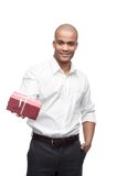 Ypund black man. Young smiling black man holding red gift isolated on white Royalty Free Stock Images