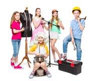 Yrke- och jobbockupation, barngrupp i yrkesmässiga dräkter, ungar på vit arkivbild