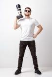 Yrkesmässig fotograf i digital kamera för t-skjorta bruk med lon Arkivfoto