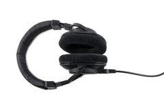 Yrkesmässig hörlurar som isoleras på vit bakgrund Arkivbild
