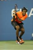 Yrkesmässig tennisspelare Gael Monfils under den andra runda matchen på US Open 2013 Royaltyfri Fotografi