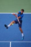 Yrkesmässig tennisspelare Grigor Dimitrov från Bulgarien under match för runda 4 för US Open 2014 Royaltyfri Fotografi