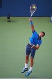 Yrkesmässig tennisspelare Grigor Dimitrov från Bulgarien under match för runda 4 för US Open 2014 Royaltyfria Foton