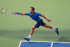 Yrkesmässig tennisspelare Grigor Dimitrov från Bulgarien under match för runda 4 för US Open 2014 Royaltyfria Bilder